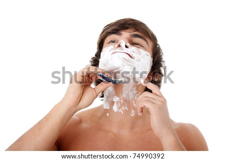 Portrait of young beautiful sexy man shaving