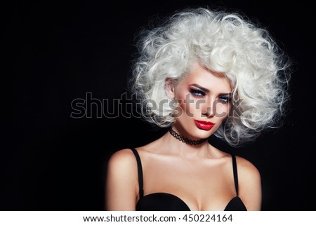 Portrait of young beautiful sexy woman with blond curly hair and chocker necklace - stock photo