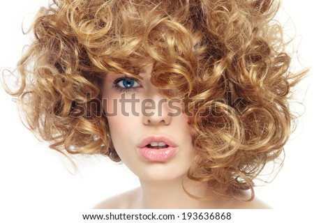 Portrait of young beautiful sexy woman with curly hair over white background - stock photo
