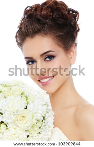 Portrait of young beautiful smiling bride with stylish make-up and hairdo over white background - stock photo