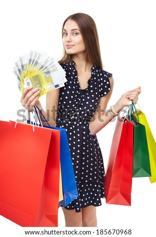 Portrait of young beautiful smiling happy woman with euro banknotes money and many colorful shopping bags isolated on white background - stock photo