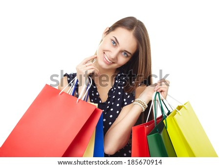 Portrait of young beautiful smiling happy woman with many colorful shopping bags touching your face isolated on white background