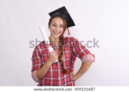 Portrait of young beautiful student with diploma and graduation cap. Isolated white background.