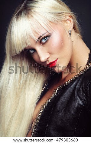 Portrait of young beautiful stylish platinum blond woman with red lipstick