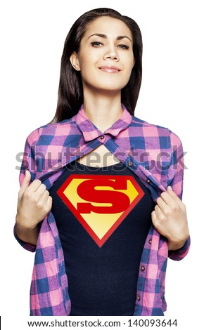 Portrait of young beautiful super woman taking her shirt off - stock photo