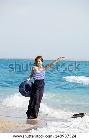 Portrait of young beautiful  tanned woman resting on the beach in summer day