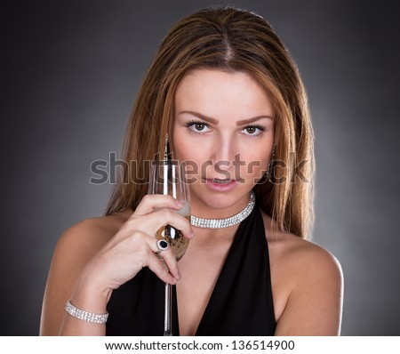 Portrait Of Young Beautiful Woman Drinking Champagne - stock photo