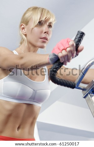 Portrait of young beautiful woman  getting busy in gym - stock photo