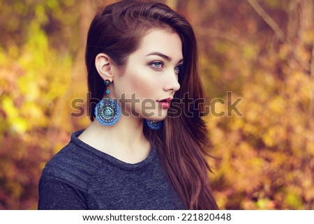 Portrait of young beautiful woman in autumn park. Beauty. Fashion photo - stock photo