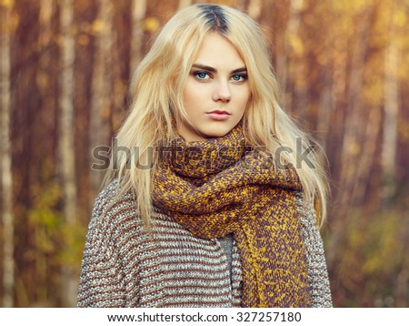 Portrait of young beautiful woman in autumn pullover. Fashion photo. Blonde girl. Perfect make-up - stock photo