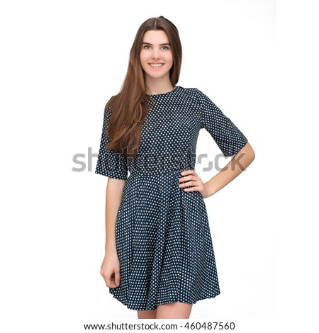 Portrait of young beautiful woman in cute dress isolated on white background. Smiling joyful and happy young girl