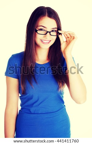 Portrait of young beautiful woman in eyeglasses. - stock photo