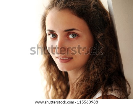 Portrait of young beautiful woman in natural light - stock photo