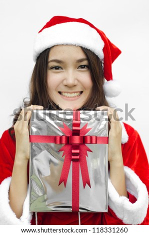 Portrait of young beautiful woman in santa claus hat with grey christmas gift box with red ribbons.