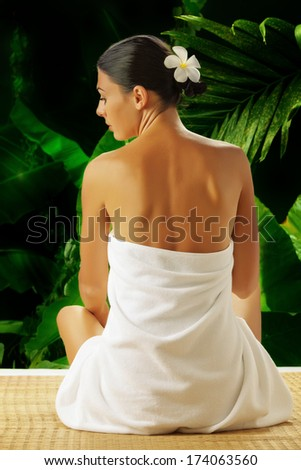 portrait of young beautiful woman  in spa environment . banner - stock photo
