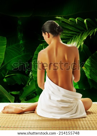 portrait of young beautiful woman  in spa environment . banner