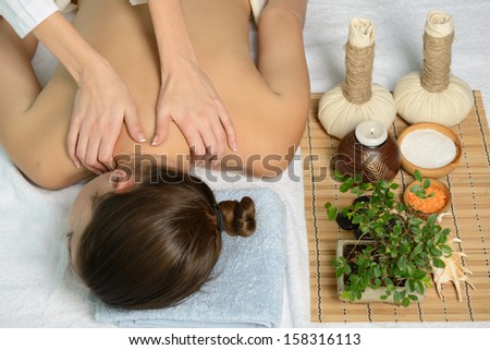 portrait of young beautiful woman in spa environment gets massage