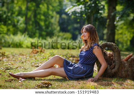 Portrait of young beautiful woman in summer forest