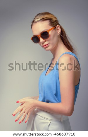 portrait of young beautiful woman in sunglasses. the white balance is incorrect.