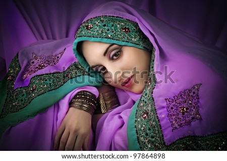 Portrait of young beautiful  woman in traditional indian costume - stock photo