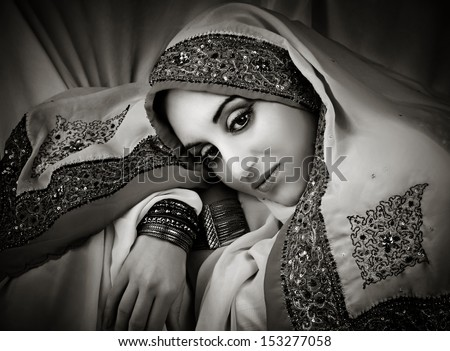 Portrait of young beautiful  woman in traditional indian costume. Black and white