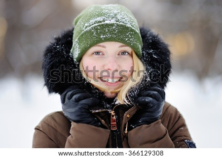 Portrait of young beautiful woman in winter  - stock photo