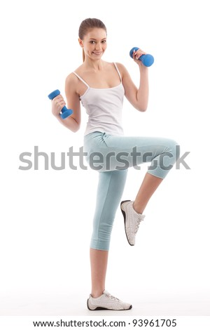 portrait of young beautiful woman making physical exercises with dumbbells isolated on white - stock photo