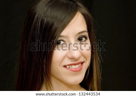 Portrait of young beautiful woman on black background