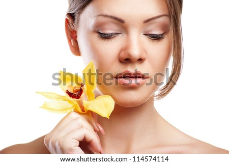 Portrait of young beautiful woman on white background with flower