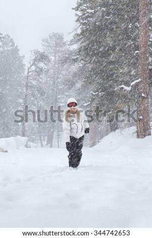 Portrait of young beautiful woman on winter outdoor background