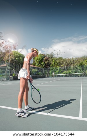 portrait of young beautiful woman playing tennis in summer environment - stock photo