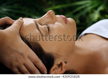 portrait of young beautiful woman relaxing in spa environment - stock photo