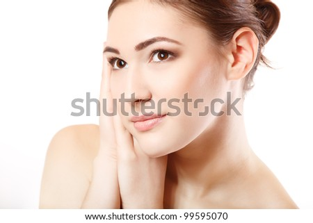 portrait of young beautiful woman smiling and holding hand near her face. isolated on white background. - stock photo