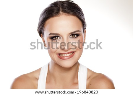 portrait of young beautiful woman with a false smile - stock photo