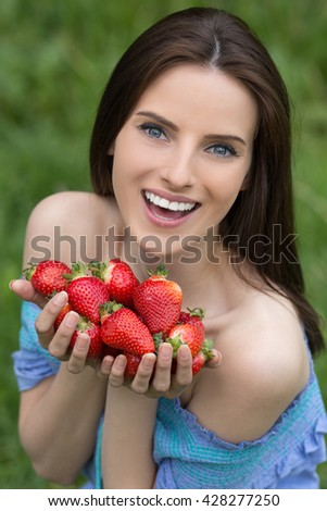 Portrait of young beautiful woman with bare shoulders and berries - stock photo