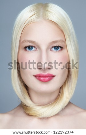 Portrait of young beautiful woman with bleached hair - stock photo