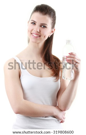Portrait of young beautiful woman with bottle of mineral water on white