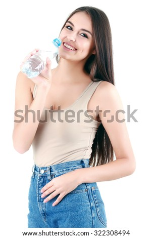 Portrait of young beautiful woman with bottle of mineral water on white - stock photo