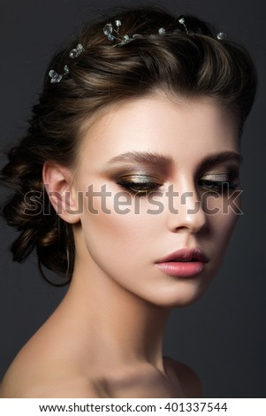 Portrait of young beautiful woman with bridal makeup and coiffure. Modern smokey eyes make up. Studio shot. Salon make-up - stock photo