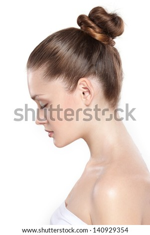 portrait of young beautiful woman with clean skin in a profile - stock photo