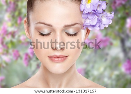 portrait of young beautiful woman with clean skin. On spring background