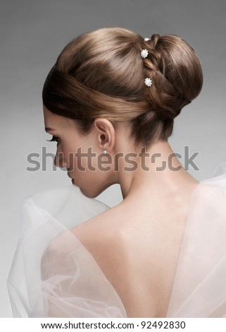 Portrait of young beautiful woman with creative elegant hairstyle - stock photo