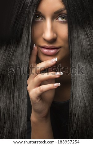 portrait of young beautiful woman with dark shiny hair - stock photo