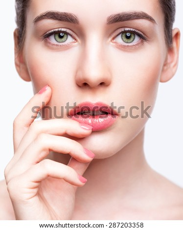 Portrait of young beautiful woman with day makeup and  green pistachio colour eyes