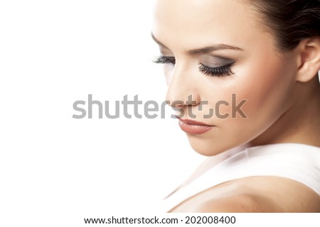 portrait of young beautiful woman with fake eyelashes - stock photo
