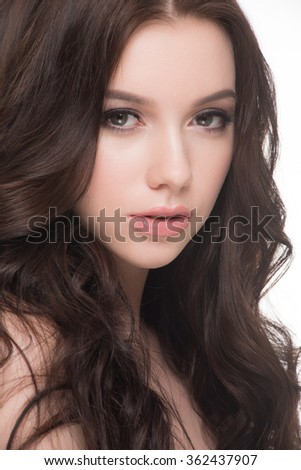Portrait of young beautiful woman with fashion makeup and hairstyle. Beauty concept.