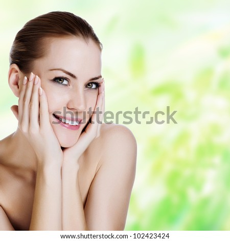 Portrait of young beautiful woman with healthy skin - stock photo