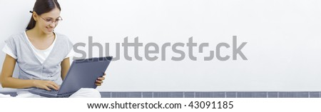 Portrait of young beautiful woman with her laptop. banner