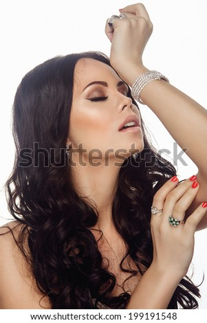 Portrait of Young Beautiful Woman with Long Hair, Clear Skin and Jewelry
