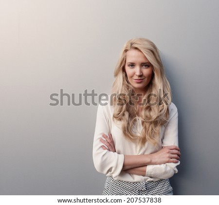 portrait of young beautiful woman with long hair have fun and good mood looking in camera and smiling - stock photo